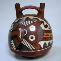 Double Spout and Bridge Bottle with Face Date: 1st–4th century Geography: Peru Culture: Nasca Medium: Ceramic, pigment
