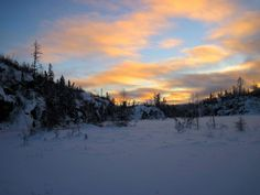 Boundary Waters sunset. Beautiful Minnesota up north in the BWCA off the Gunflint Trail near Tuscarora Lodge and Canoe Outfitters. Amazing sight during a winter snowshoe trek in the Boundary Waters.