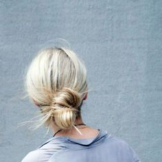 The Tucked Bun - Create dimension with a low bun style by looping hair halfway through an elastic, leaving the ends free. Finish by creating a second loop with the loose hair, and tucking and arranging ends haphazardly into the elastic for a slightly disheveledeffect.