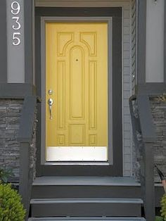 Another gray house with yellow door idea