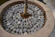 Use river rock to make a decorative pebble mosaic pattern in a planter Garden Landscaping, Garden Paths, Garden Art, Lawn And Garden, Garden Design, Amazing Gardens, Beautiful Gardens, River Rocks, River Stones
