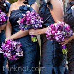 Shades of purples bouquet against navy blue dress. Use stock, wax flower, motsomoto asters, cushion poms, football mums, dendro or cymb