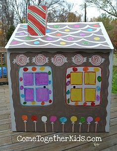 a cardboard gingerbread house...my kids would love painting a cardboard house, this one was purchased but we (Brian) could totally put one together from boxes, great activity for the basement this winter