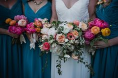 Romantic Barn Wedding. Coral and peach bridesmaids bouquets and romantic bridal bouquet. Peonies, Ranunculus and Garden Roses. photo by Meg Bisson