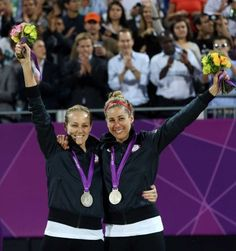 Jennifer Kessy and April Ross take silver in women's beach volleyball.