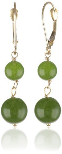 Glossy dark green rounds of dyed Taiwan jade dangle from 14 karat yellow gold wires in these attractive earrings. Each earring holds a chain of two jade beads, graduated in size, with the largest measuring 8 millimeters. These elegant dangles are finished with simple and secure leverback closures. Regarded in many cultures as a symbol of good luck, jade is said to have a harmonizing effect on its wearer.