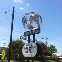 Even signage is artsy, y'all! Star Pizza's globe built by Houston Art Car legend Mark Bradford | Houston, Texas.