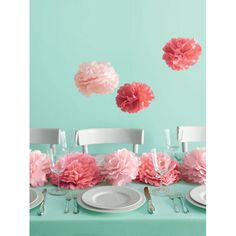 Martha Stewart medium pink pom poms set are pretty decoration for your baby shower for girl. From $22.50.