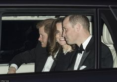 The cheerful trio appeared to be in high spirits sharing a joke as they made their way to the reception in the royal