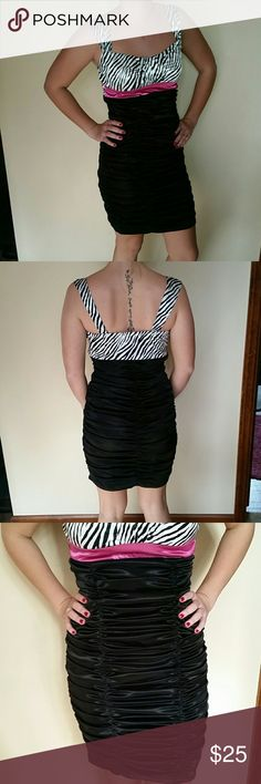 Ruby Rox size M dress Ruby Rox size M dress. Black and white zebra top. Black bottoms. Ruching on entire dress. Fuchsia  accent under chest. Ruby Rox Dresses Prom