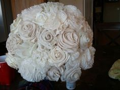 a really amazing diy bouquet using ivory burlap, muslin, chiffon, lace different kinds), a regular cotton a few other fabrics. handle is wrapped in twine. so gorgeous! Broch Bouquet, Flower Boquet, Burlap Flowers, Diy Flowers, Fabric Flowers, Fabric Bouquet, Diy Bouquet, Wedding Hair Flowers, Wedding Bouquets
