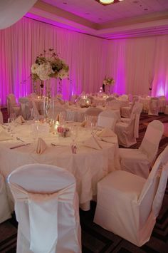 Ivory wedding linens with pink uplighting  www.whitetable.com