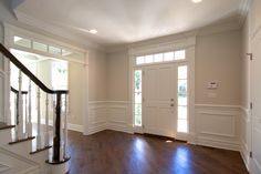 #Foyer. Dark stained floors, gorgeous #moldings, the perfect ambiance to receive guests.
