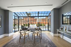 Sun streams into the office at this two-story New York City penthouse, found inside the iconic Puck Building, a SoHo staple since 1886. | archdigest.com