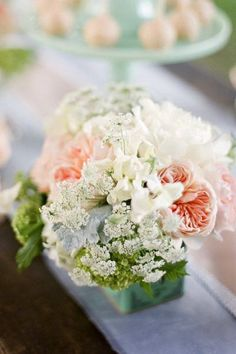 Juliet roses and Queen Anne's lace.  Adorable!
