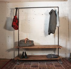 Clothing rack with plenty of storage space. Two levels of shelving. The clothing rack can be assembled by hand in short period of time. The platforms are removable. It's 4ft long and wheels have break