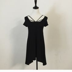 ☀JUST REDUCED!! SMALL BLACK CUTE DRESS!!☀️ Brand New!! Black Solid short sleeve dress with criss cross detail at neck line. Asymmetrical hem line.  Super soft: 95%rayon, 5%spandex.  Will accept a reasonable offer- last piece- small!! April Spirit Dresses Mini