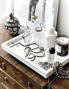 Love the contrast- metal frame, white tray and wood furniture. Modern and classic at the same time.