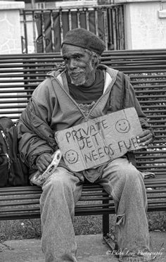 "Homeless man holding sign that reads, ""Private jet needs fuel."" I love a man with a sense of humor, particularly a homeless one. That's swag! (Edith Levy: New Orleans street photography)"