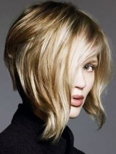 KInverted asymmetrical wavy blonde bob // Thing I might do to my hair.