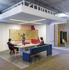 Floor material + lower ceiling plane + casual seating + pinup wall = crit space