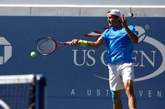 Tommy Haas (GER)[21] in action against  Ernests Gulbis (LAT)  in the first round. - Philip Hall/USTA
