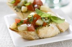 Want to please the home crowd? Serve them crostini spread with basil-Parmesan pesto and topped with chopped tomatoes and cubes of mozzarella.