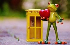 Figurine of frog with heart and lantern