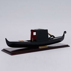 @Overstock - The most famous and characteristic symbol of Venice is the Gondola. This boat represents a typical Venetian Gondola circa 1882. The model now is rebuilt without the roof in the middle of the boat and used to carry tourists along the Venice river in Italy.http://www.overstock.com/Main-Street-Revolution/Old-Modern-Handicrafts-Small-Venetian-Gondola-Model/6153177/product.html?CID=214117 $159.99