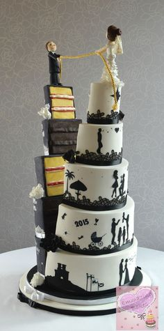 This cake depicts the couple pulling their lives together in marriage. The black side has their own love story written in chalkboard style and the white side is silhouette pictures of their story