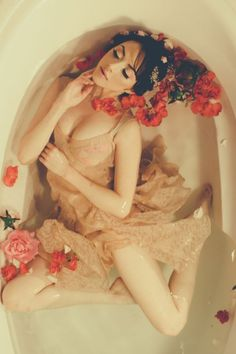 Enchanted Bathtub Boudoir Session  Photograph by [a.w. photography] http://www.storyboardwedding.com/enchanting-bathtub-boudoir-session-surrounded-by-free-flowing-fabric-rosey-blooms/