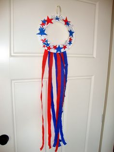 Ivan's 4th of July wreath on the front door. We're adding a little 4th of July fun into our school days this week. My kids are so exci...