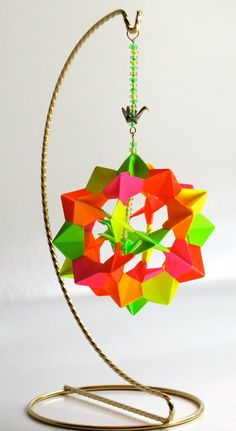 Ornament Decoration Home Décor Modular Origami Handmade in Neon Fluorescent Colors on a Gold OOaK https://www.etsy.com/treasury/NTM5ODkzNXwyNzI0NzM1MTYy/cosmic-neon