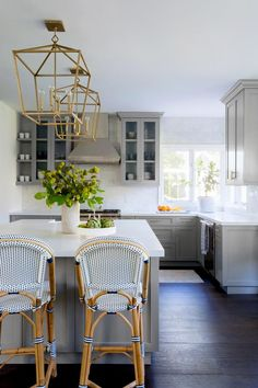 Modern Farmhouse Kitchen: Serena & Lily Riviera Counter Stools sit at a gray island lit by two antique brass Darlana Lanterns. Modern Farmhouse Kitchens, Cool Kitchens, White Kitchen Cabinets, White Counters, Open Cabinets, Kitchen White, Kitchen Island, Kitchen Windows, Shaker Cabinets