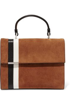 Tomasini's 'Stratoss' tote has been entirely handmade by local artisans in Abruzzi, Italy. Crafted from the label's signature 'cashmere suede' in tan, this piece is detailed with black and white leather stripes - inspired by '70s racing cars. Stow your wallet and makeup essentials in the smooth satin interior.