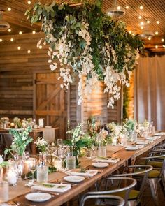 chic rustic wedding reception decorations with hanging white and greenery floral #weddingdecor #weddingideas #weddingreception #weddingflowers #weddingfloral #weddinginspiration