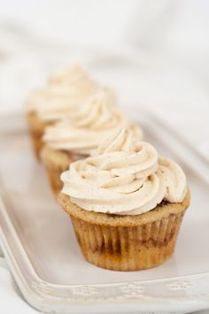 Cinnamon Butterscotch Cupcakes with Cinnamon Frosting- Sweet cupcakes with an interesting twist. Butterscotch bits and cinnamon make these cupcakes unique and the cinnamon buttercream frosting is both pretty and tasty.