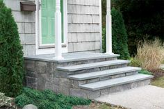 In this video, TOH senior technical editor Mark Powers shows how to cover up an ugly concrete stoop with stone veneer and bluestone treads. Concrete Front Steps, Cement Steps, Front Porch Steps, Brick Steps, Front Stairs, Concrete Porch, Front Stoop, Concrete Stairs, Concrete Tiles