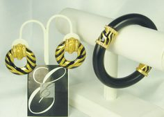 SALE $189.99 The Zebra Stripe #bracelet and #earrings by Elizabeth Taylor for Avon. This set is so bold having bright 22kt #gold plated metal with #black enamel forming the Zeb... #vintage #judysgems2 #teamlove #avon
