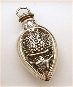 sterling silver flask or vial perfume bottle with raised design of flowers in urn