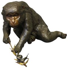 Charming Antique Japanese Bronze of a Monkey Playing with a Snail 1