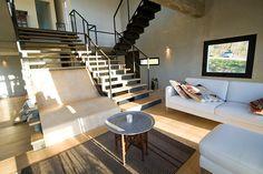 barilari architetti builds stone picture house with concrete frames