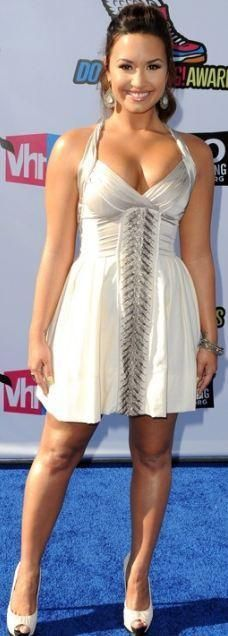 Who made Demi Lovato's white dress and pumps that she wore in Los Angeles? Dress – Burning Torch Shoes – Guiseppe Zanotti