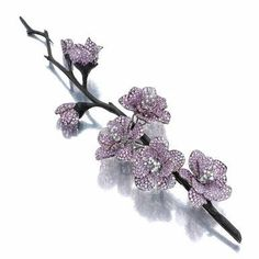 Pink sapphire and diamond brooch, 'Fleurs de Pêcher', Michele della Valle. The petals set with circular-cut pink sapphires, the pistils en tremblant with brilliant-cut diamonds, mounted in carbon fiber and white gold. High Jewelry, Jewelry Art, Antique Jewelry, Vintage Jewelry, Jewelry Accessories, Jewelry Design, Bling Jewelry, Spring Blooming Flowers, Saphir Rose
