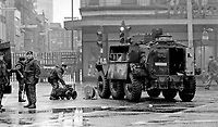Army technical officer ATO using Goliath bomb disposal robot Belfast N Ireland 1973 | Victor Patterson