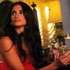 Penelope Cruz in the 2001 movie Blow ⚡️⚡️I need that gold telephone in my life too ✨