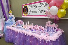 Princess Party Decorations - Table skirt of purple gathered tulle with clear Christmas ice sickle lights underneath and pink feather boa trim around the top.