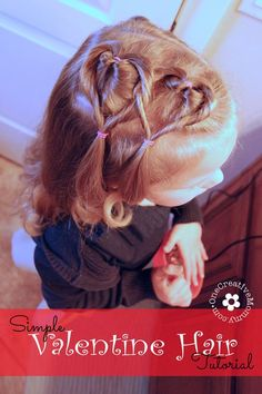 Create this easy Valentine hair style in ten minutes or less!  I'll show you how.  {Valentines Day heart hair style for little girls on OneCreativeMommy.com}
