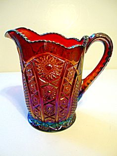 A carnival glass pitcher