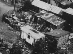 1956 Dans le cadre d'une série d'émissions sur la restructuration urbaine à la périphérie de Paris, le journaliste Claude JOUBERT présente les chantiers de constructions
